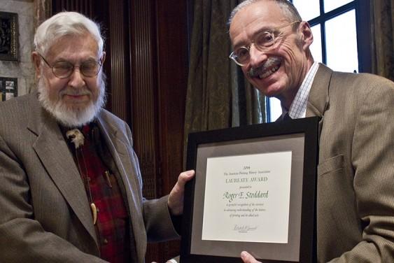 Roger Stoddard accepts APHA's 2014 Individual Award from President Robert McCamant. (Joel Mason)