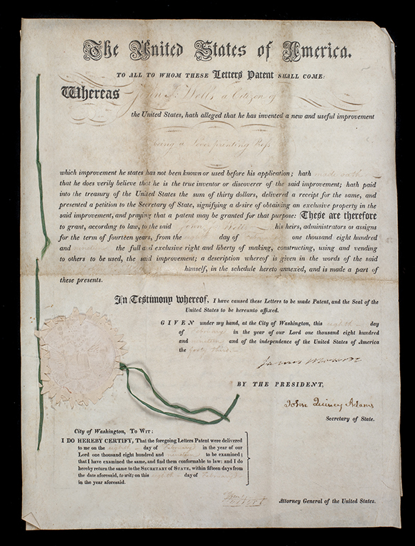 Vellum sheets. Handwritten patent letters issued to John Wells for a lever printing press, 1819, patent number X3070. 1981.0252.01.
