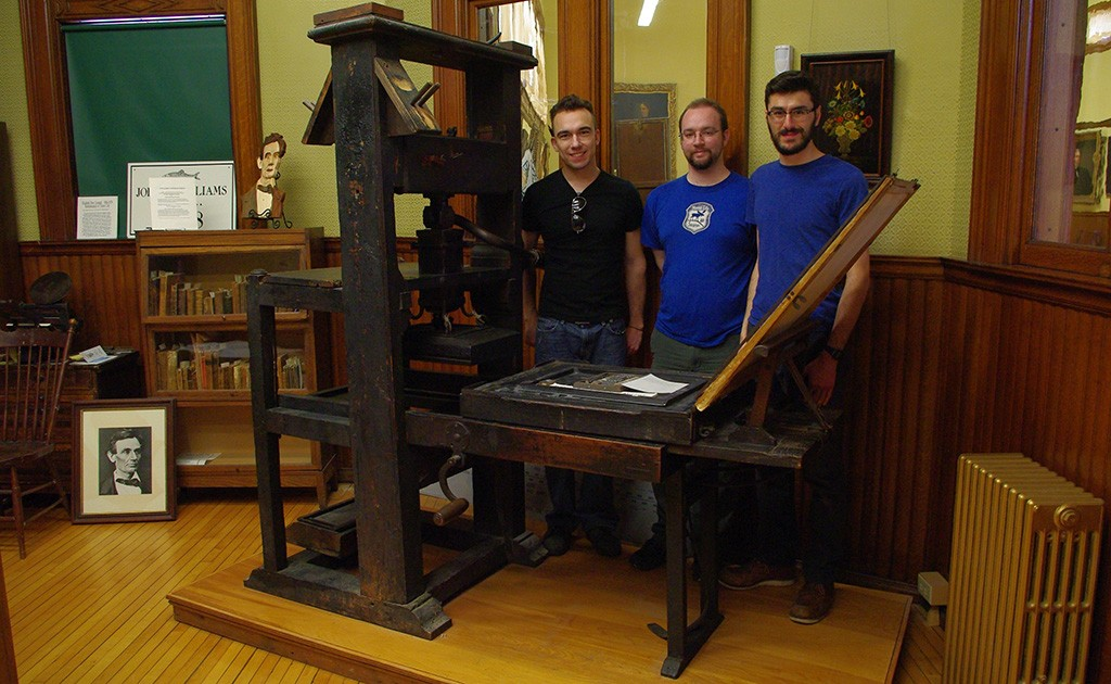 The Robert Luist Fowle Press with team mates (from left to right) Daniel Krull, Randall Paulhamus, and Seth Gottlieb.