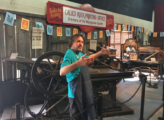 "Mark Barbour introduces us to the International Printing Museum's late-nineteenth-century ""Grasshopper"" newspaper press. (Jess Touchette)"