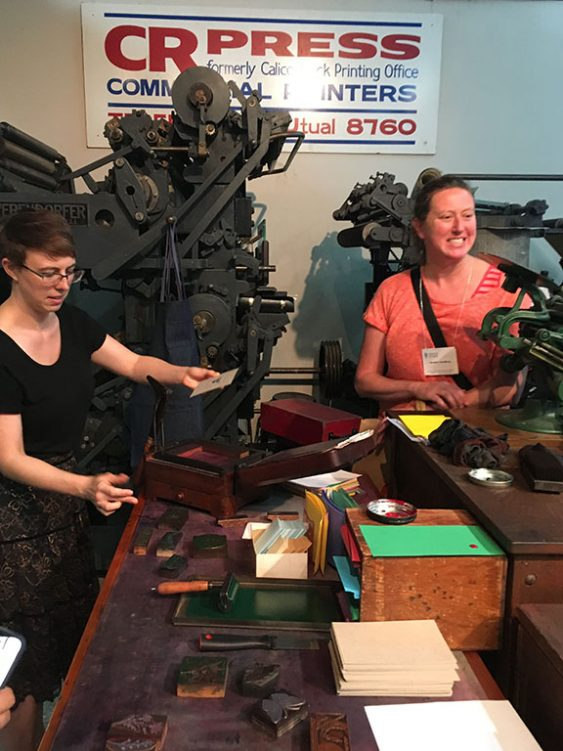 APHA members test out the museum's parlor press. (Jess Touchette)