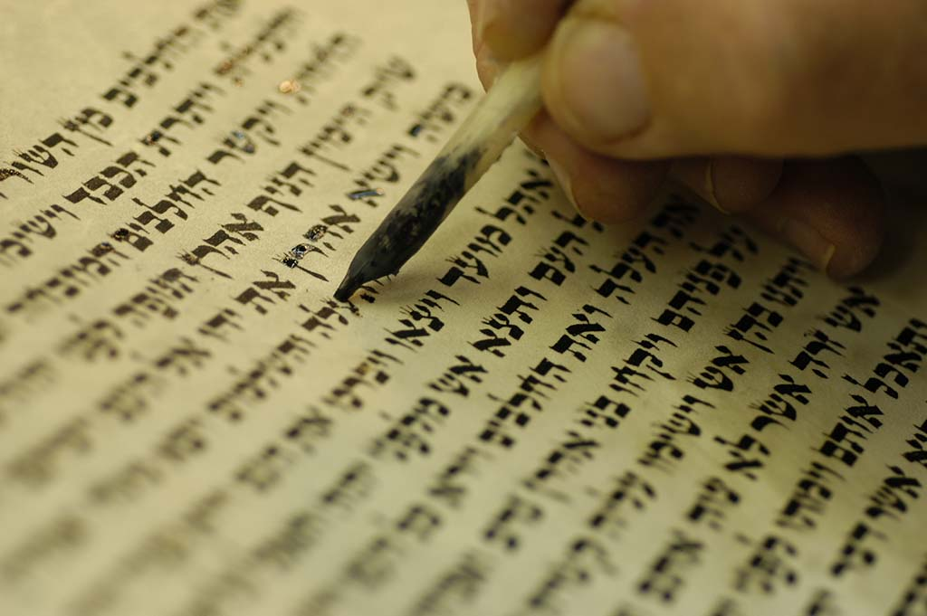 Scribe re-lettering a Torah scroll to keep it kosher. (Tom Kilpatrick)