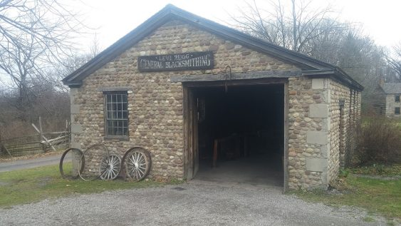 The Levi Rugg blacksmith shop, built in 1830 in Elba, NY and moved to Genesee Country Village. Rugg purchased the shop from his competitor and was active until his death in 1875. The shop was actively used by blacksmiths into the twentieth century. (Photo courtesy Matthew Schofield)