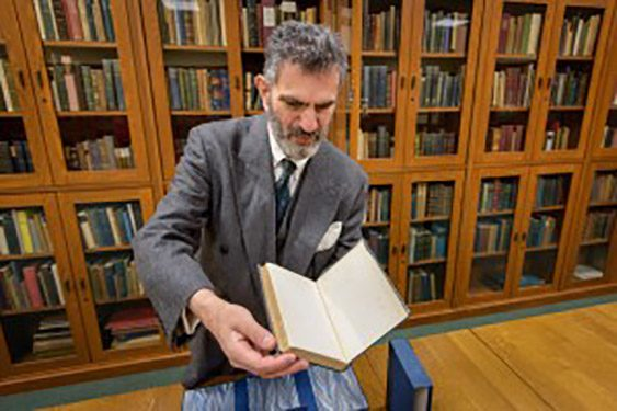 Mark Samuels Lasner and his collection in the Morris Library. (Evan Krape / University of Delaware)